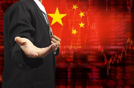 sell shares: Flag of China. Downtrend stock data diagram with business man with empty hand Stock Photo