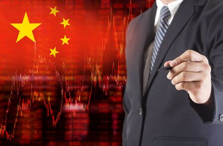 negative equity: Flag of China. Downtrend stock data diagram with Businessman writing, drawing on the screen Stock Photo