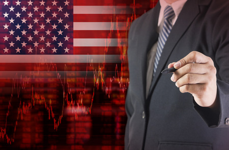 Crisis in USA - Shares Fall Graph on United States of America Flag with Businessman writing, drawing on the screen