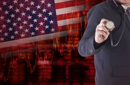 Crisis in USA - Shares Fall Graph on United States of America Flag with Businessman hand holding a stethoscope analyze solution ideas concept design
