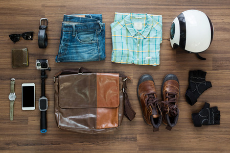 travel collage: hipster clothes and accessories on a wooden background, View from above with copy space
