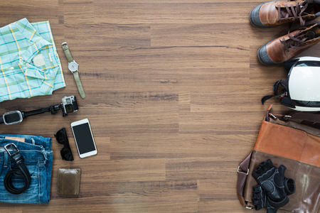 apparel: hipster clothes and accessories on a wooden background, View from above with copy workspace