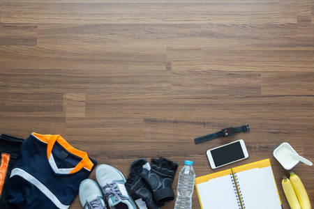 sport clothes: Sport clothes and accessories on a wooden background, View from above with copy workspaces Stock Photo