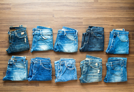 jeans pocket: Collection jeans stacked on a wooden background, View from above
