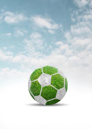 blue ball: Green grass of soccer ball design on clouds blue sky background