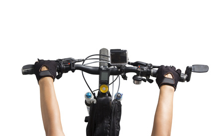 handle bars: Women riding on a bicycle, Close up bicycle handlebar riders hands on a mountain bike, isolated white background