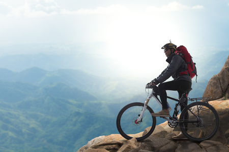 Cyclist on the top of a hill