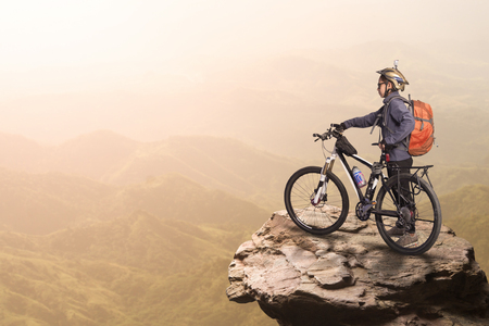 extreme sports: Woman cyclist on the top of the hill Stock Photo