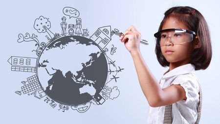 global environment: Little girl creative drawing on global environment with ecology happy family stories concept idea Stock Photo