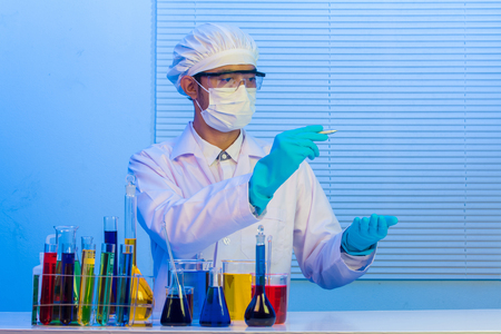 Man scientist holding pen drawing for design work