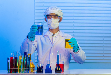 Man scientist holding a test tube with liquid Stock Photo