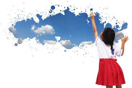 Schoolgirl paint sky on the wall