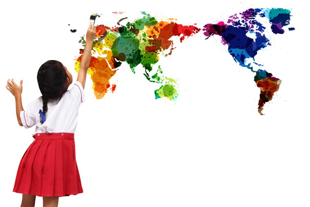little girl painting watercolor world map on a white wall