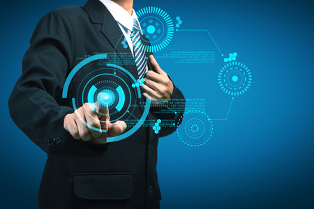 Businessman touching sci fi futuristic user interface. Stock Photo