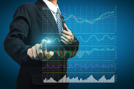 Stock Analysis ideas concept businessman pointing or touching the trading graph of stock market on the virtual screen Foto de archivo