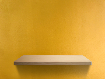 Wood shelf on yellow wall texture