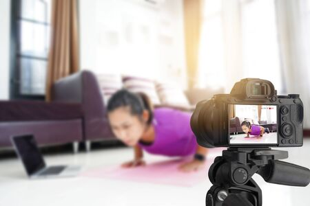 Asian women exercise workout at home, With recording making video for blog
