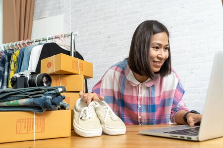 Asian women working laptop computer selling shoes online start up small business owner, e-commerce ideas concept Imagens
