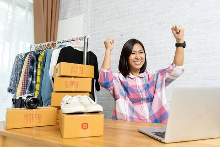 Asian women successful happy selling online after new order, Start up small business owner working laptop computer, e-commerce ideas concept Imagens