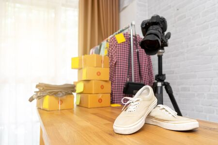 Taking photo to shoes with digital camera for post to selling online on the internet, Start up small business owner e-commerce ideas concept Imagens