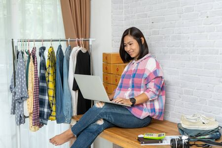 Asian women working laptop computer at home selling online start up small business owner, e-commerce ideas concept Imagens