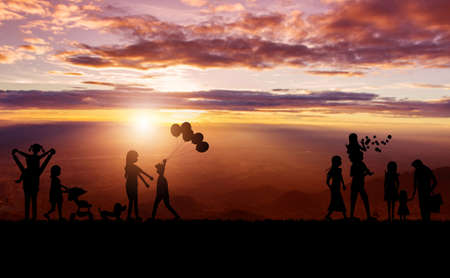 Silhouette of family and sky sunset background