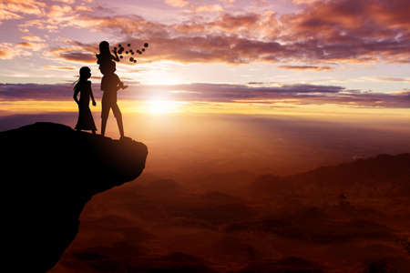 Silhouette of family on the top hills and sky sunset background