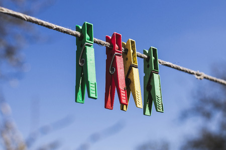 clothespins in different colours on the Å¡nora