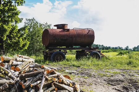 Standing in the rusted barrel and the cover of the tractor
