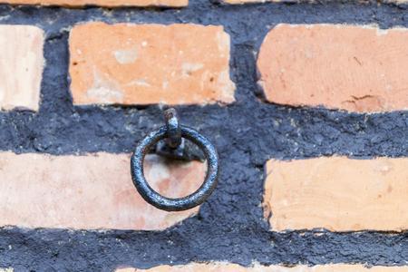 round iron ring a brick wall