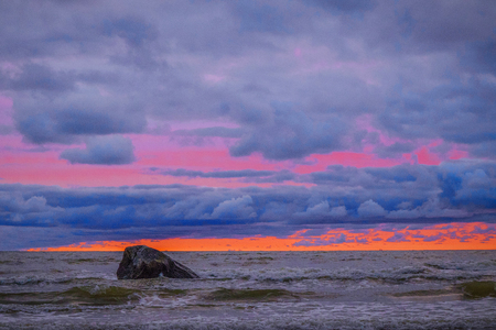a coloured the sky above the sea with a stone Stock Photo