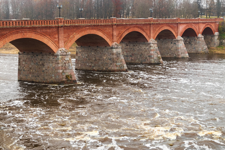 Latvia. For the Venta River across to a beautiful old bridge Stock Photo