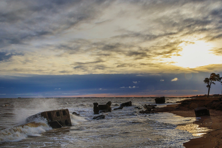 Waves beating against Latvia.Liepaja.Karosta. described the fortress ruins Stock Photo