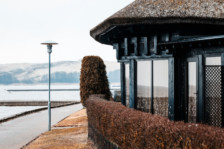 an old house on the seaside with a reel roof