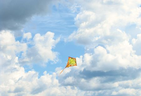 Kite in flight. Weather cloudy.