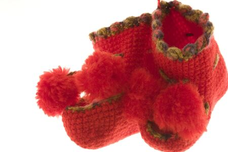 Childrens red knitted bootees