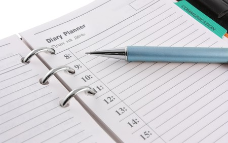 The datebook open on page with the day plan Stock Photo