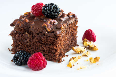 Sweet homemade brownie with forest fruits.