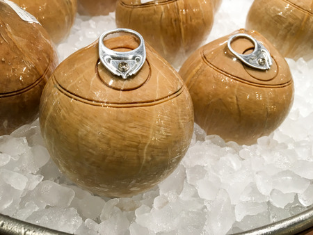 can opener: Coconut with can opener in the ice bucket