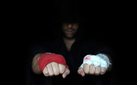 Professional taping and dabbler taping. Boxers fists comparison Reklamní fotografie