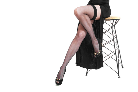 Sexy female legs in high-heeled black shoes and fishnet stocking, isolated on white Stockfoto