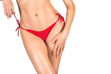 Sexy female body in red panties, tanned skin, bikini line epilation, isolated on white