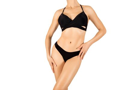 Woman fit cropped body in black bikini, isolated on white Stockfoto