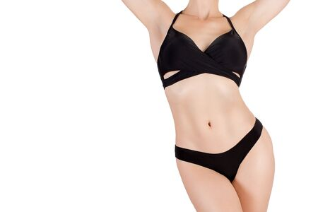 Female sexy fit cropped body in black sporty bikini, isolated on white