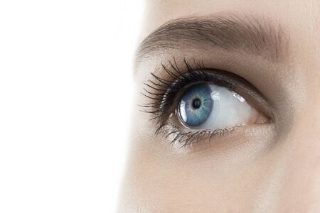 Female open blue eye with contact lens, close up. Medicine, irritation, sore, laser surgery, eyesight, vision correction, allergy and lens concept