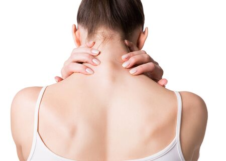 Muscle spasm, neck, trapezoid and shoulders pain. Female back in white top, isolated on white.