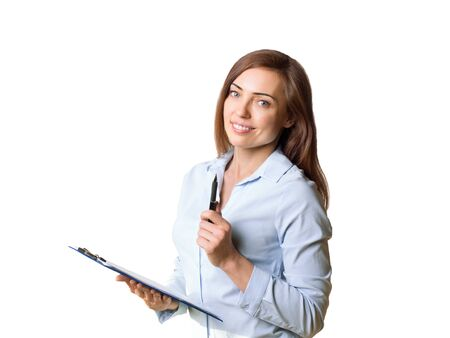 Attractive smiling woman manager in formal wear makes a presentation of product or service, using a pen and a clipboard, isolated on white.