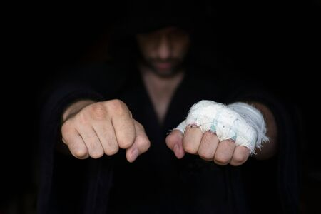 Taping fists of pro fighter who ready to boxing
