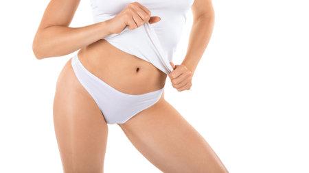 Bikini line depilation. Sexy female lower body in white panties, wellgroomed skin, isolated on white