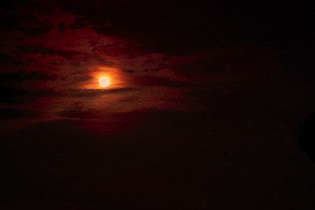 Moon eclipse - planet red blood with clouds Foto de archivo